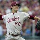 File - In this June 8, 2012, file phot, Stanford pitcher and first-round draft pick Mark Appel throws during a NCAA college baseball tournament super regional game against Florida State in Tallahassee, Fla. Appel chose to remain at Stanford for his senior season instead of signing with the Pittsburgh Pirates. (AP Photo/Phil Sears, file)