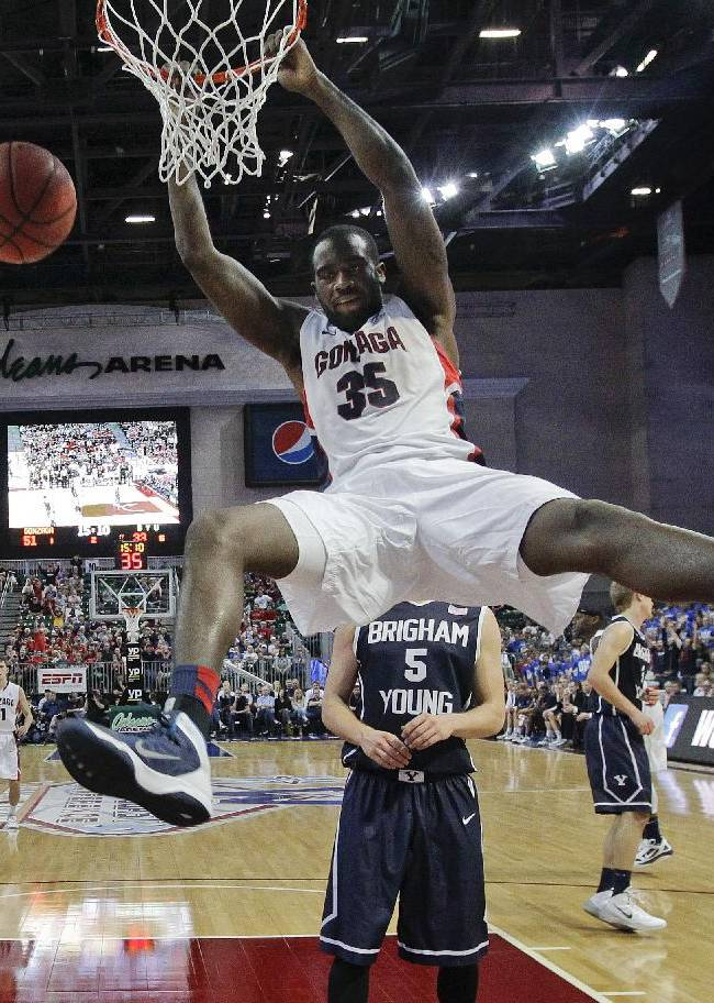 Gonzaga's Sam Dower Jr. dunks against BYU in the second half of an NCAA college basketball game for the West Coast Conference men's tournament title, Tuesday, March 11, 2014, in Las Vegas. Gonzaga won 75-64