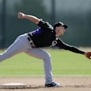 Colorado Rockies shortstop Troy Tulowitzki reaches for a throw to second base during a spring training baseball practice Wednesday, Feb. 26, 2014, in Scottsdale, Ariz The Associated Press
