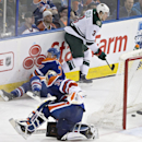 Minnesota Wild's Charlie Coyle (3) skates away after scoring a goal on Edmonton Oilers goalie Viktor Fasth (35) as Andrew Ference (21) tries to defend during the third period of an NHL hockey game Tuesday, Jan. 27, 2015, in Edmonton, Alberta The Associate