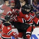 New Jersey Devils' Zach Parise, center, embraces Bryce Salvador after Salvador scored against the New York Rangers during the first period of Game 4 of an NHL hockey Stanley Cup Eastern Conference final playoff series, Monday, May 21, 2012, in Newark, N.J. (AP Photo/Kathy Willens)
