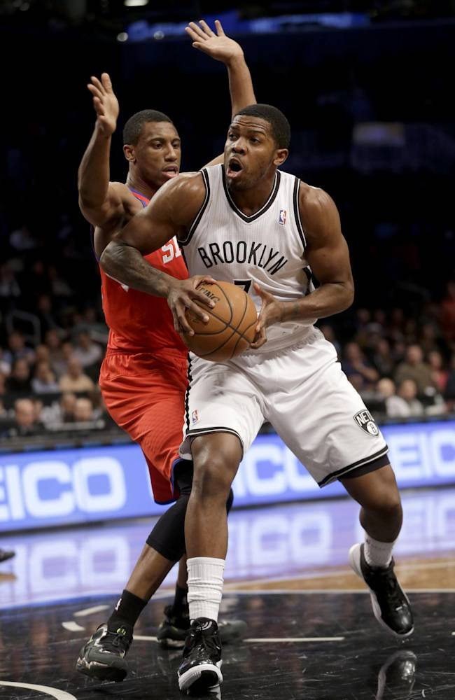 Brooklyn Nets' Joe Johnson, right, looks for the basket past Philadelphia 76ers' Thaddeus Young during the first half of an NBA basketball game at the Barclays Center, Monday, Dec. 16, 2013, in New York