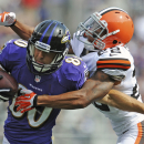 Cleveland Browns cornerback Buster Skrine, right, wraps up Baltimore Ravens wide receiver Brandon Stokley during the second half of an NFL football game in Baltimore, Md., Sunday, Sept. 15, 2013. (AP Photo/Gail Burton)