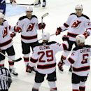 New Jersey Devils' Michael Ryder (17), Adam Henrique (14), Eric Gelinas (22), Andy Greene (6) and Ryane Clowe (29) celebrate Clowe's goal against the New York Islanders in the second period of an NHL hockey game on Saturday, March 1, 2014, in Uniondale, N