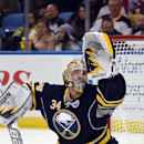Buffalo Sabres goaltender Michal Neuvirth, of the Czech Republic, reaches up with his glove as the puck deflects off the crossbar during the second period of an NHL hockey game against the Detroit Red Wings Tuesday, Jan. 13, 2015, in Buffalo, N.Y. Detroi