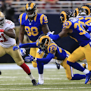 San Francisco 49ers running back Frank Gore (21) gets past St. Louis Rams free safety Rodney McLeod (23) in the first quarter of an NFL football game Monday, Oct. 13, 2014, in St Louis The Associated Press