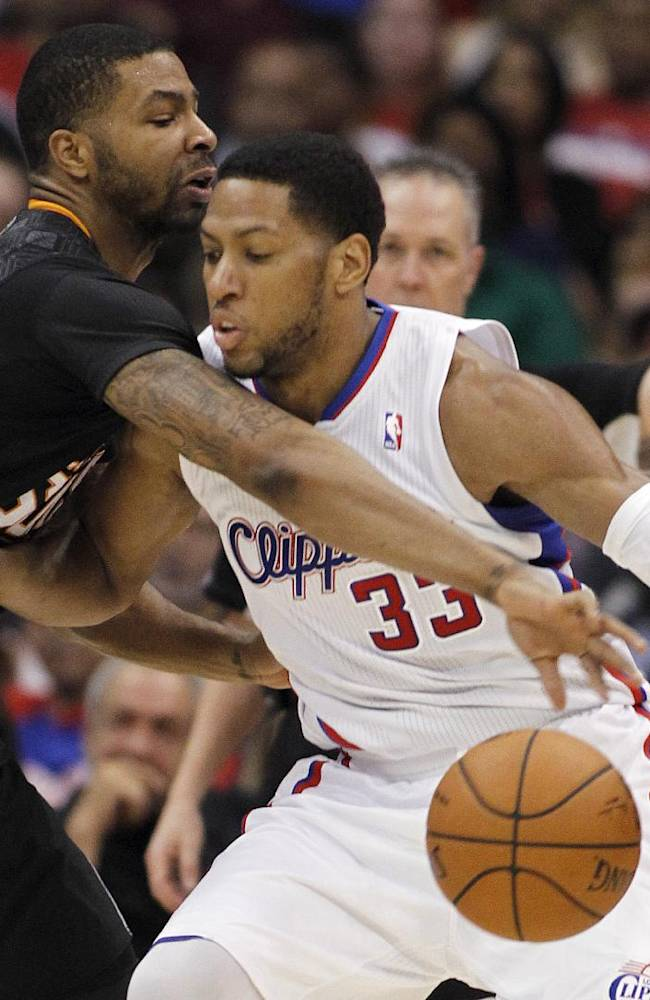 Phoenix Suns forward Marcus Morris, left, reaches in to steal the ball away from Los Angeles Clippers forward Danny Granger (33) during the second half of an NBA basketball game Monday, March 10, 2014, in Los Angeles. Clippers won 112-105