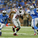 New York Giants running back Rashad Jennings breaks through the Detroit Lions defense during the second quarter of an NFL football game in Detroit, Monday, Sept. 8, 2014 The Associated Press