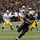 New Orleans Saints inside linebacker David Hawthorne (57) intercepts a pass by Green Bay Packers quarterback Aaron Rodgers (12) in the second half of an NFL football game in New Orleans, Sunday, Oct. 26, 2014 The Associated Press