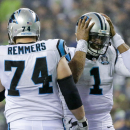 Carolina Panthers quarterback Cam Newton, right, grabs his helmet next to tackle Mike Remmers during the second half of an NFL divisional playoff football game against the Seattle Seahawks in Seattle, Saturday, Jan. 10, 2015 The Associated Press