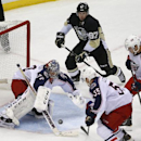 Columbus Blue Jackets goalie Sergei Bobrovsky (72) grabs a rebound on a shot by Pittsburgh Penguins' Sidney Crosby (87) in the first overtime period of a first-round NHL playoff hockey game in Pittsburgh, Saturday, April 19, 2014 The Associated Press