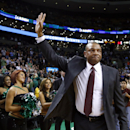Doc Rivers, former head coach of the Boston Celtics and current head coach of the Los Angeles Clippers, waves to cheering fans as he enters the TD Garden floor for his first time back, before an NBA basketball game in Boston, Wednesday, Dec. 11, 2013 The