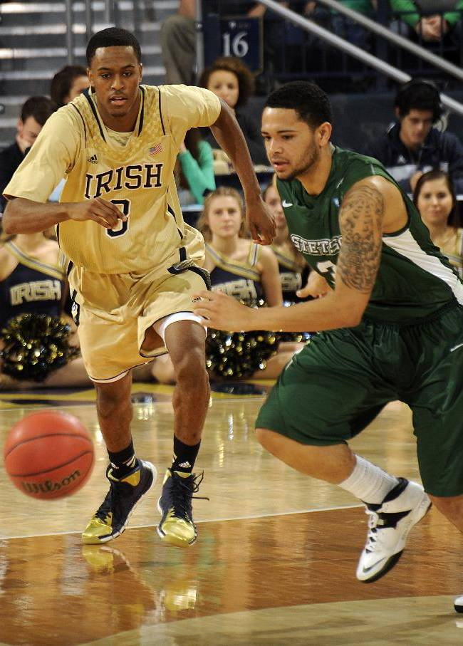 Stetson guard Glenn Baral, right, and Notre Dame guard V.J. Beachem chase a loose ball during the first half of an NCAA college basketball game on Sunday, Nov. 10, 2013, in South Bend, Ind