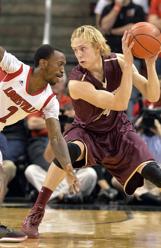 Louisville's Russ Smith, left, attempts to steal the ball from the College of Charleston's Canyon Barry during the second half of an NCAA college basketball game, Saturday, Nov. 9, 2013, in Louisville, Ky. Louisville defeated the College of Charleston 70-48
