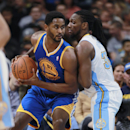 Golden State Warriors forward Hilton Armstrong, left, works the ball inside for shot as Denver Nuggets forward Kenneth Faried covers in the third quarter of the Warriors' 116-112 victory in an NBA basketball game in Denver on Wednesday, April 16, 2014 The