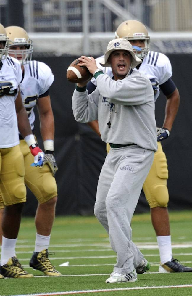 In this Aug. 22, 2013 file photo, Notre Dame defensive coordinator Bob Diaco works with the defense during NCAA college football practice in South Bend, Ind. Connecticut has hired Notre Dame defensive coordinator Bob Diaco as its football coach. The school announced the move early Thursday morning, Dec. 12, 2013