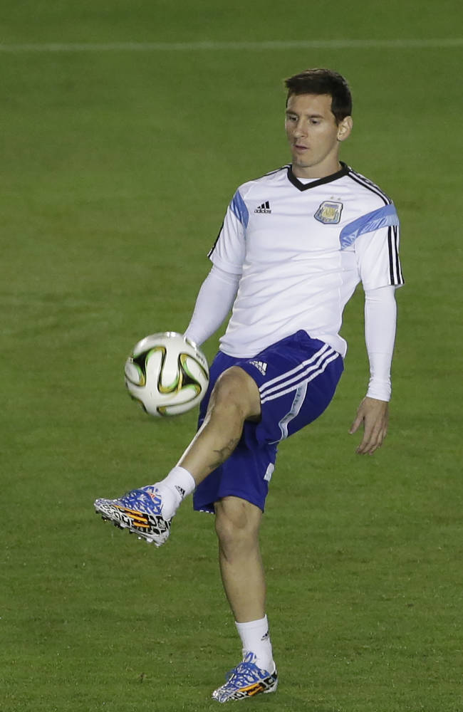Argentina's Lionel Messi controls the ball during an official training session at the Vasco da Gama stadium the day before the World Cup final soccer match between Germany and Argentina in Rio de Janeiro, Brazil, Saturday, July 12, 2014