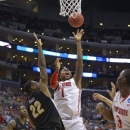 Ohio State forward Deshaun Thomas (1) shoots next to gainst Wichita State forward Carl Hall (22) during the second half of the West Regional final in the NCAA men's college basketball tournament, Saturday, March 30, 2013, in Los Angeles. Wichita State's Malcolm Armstead is at left. (AP Photo/Mark J. Terrill)