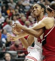 Nebraska guard Kaitlyn Burke (5) fouls Ohio State guard Tayler Hill, left, in the first half of an NCAA college basketball game during the semifinal round of the women's Big Ten Conference tournament in Indianapolis, Saturday, March 3, 2012. (AP Photo/AJ Mast)