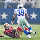 San Francisco 49ers wide receiver Michael Crabtree (15) fumbles as he is tackled by Dallas Cowboys cornerback Brandon Carr (39) during the second half of an NFL football game Sunday, Sept. 7, 2014 in Arlington, Texas The Associated Press