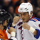 In this Nov. 4, 2010, file photo, Philadelphia Flyers' Jody Shelley, left, and New York Rangers' Derek Boogaard fight during an NHL hockey game in Philadelphia. A former minor league hockey player has been arrested on charges he sold illegally obtained pr