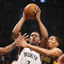 Brooklyn Nets shooting guard Joe Johnson (7) shoots against Los Angeles Lakers shooting guard Wesley Johnson (11) in the first quarter of an NBA basketball game at the Barclays Center, Wednesday, Nov. 27, 2013, in New York The Associated Press