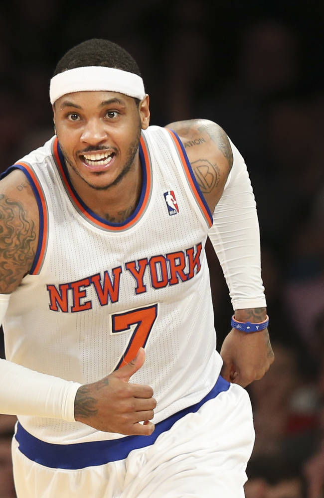 New York Knicks forward Carmelo Anthony celebrates after scoring during the second half of an NBA basketball game against the Atlanta Hawks, Saturday, Dec. 14, 2013, in New York. The Knicks won 111-106
