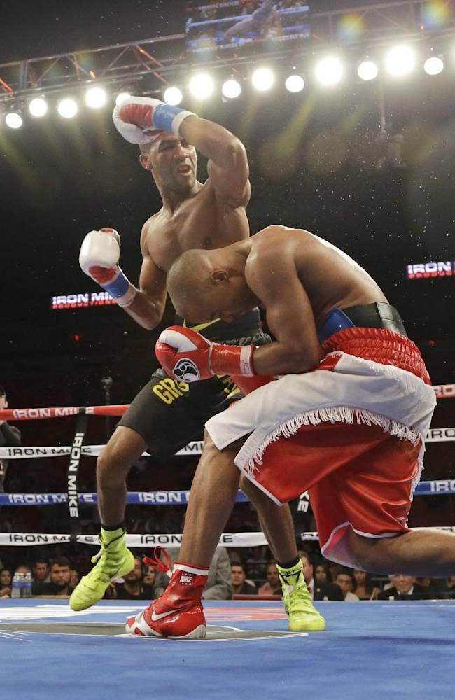 Rances Barthelemy, center top, fights Argenis Mendez on Friday, July 11, 2014, during a boxing match begun late Thursday in Miami. Barthelemy won a unanimous decision over Mendez and captured the International Boxing Federation junior-lightweight title