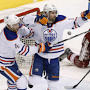 Edmonton Oilers' Sam Gagner (89) celebrates his goal against the Phoenix Coyotes with teammate Taylor Hall (4) during the third period of an NHL hockey game, Friday, April 4, 2014, in Glendale, Ariz. The Oilers defeated the Coyotes in a shootout, 3-2 The