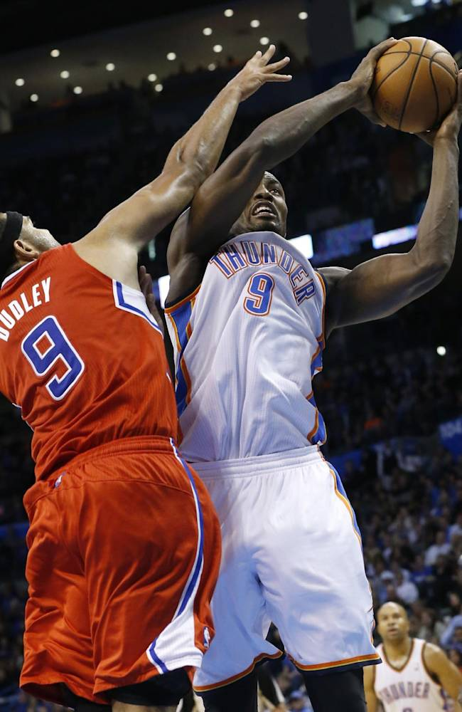 Oklahoma City Thunder forward Serge Ibaka, right, shoots in front of Los Angeles Clippers forward Jared Dudley, left, in the fourth quarter of an NBA basketball game in Oklahoma City, Thursday, Nov. 21, 2013. Oklahoma City won 105-91