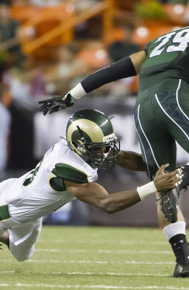 Colorado State defensive back DeAndre Elliott (13) misses a tackle on Hawaii wide receiver Scott Harding (29) in the second quarter of an NCAA college football game Saturday, Oct. 26, 2013, in Honolulu