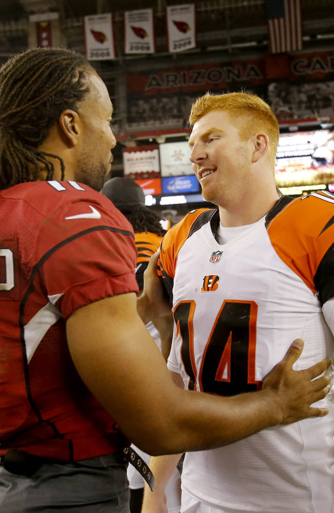 Arizona Cardinals wide receiver Larry Fitzgerald (11) greets Cincinnati Bengals quarterback Andy Dalton (14) after an NFL preseason football game, Sunday, Aug. 24, 2014, in Glendale, Ariz. The Bengals won 19-13