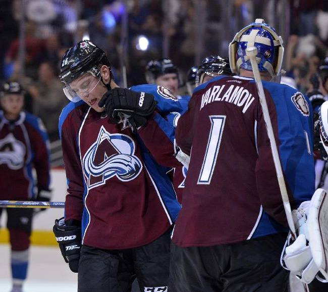Colorado Avalanche center Paul Stastny (26) is congratulated by Colorado Avalanche goalie Semyon Varlamov (1) from Russia after scoring a goal against the Minnesota Wild  to tie the game and send it to overtime during the third period in Game 1 of an NHL hockey first-round playoff series on Thursday, April 17, 2014, in Denver