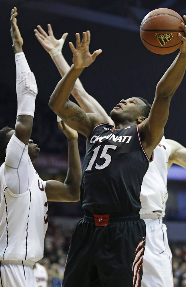 Cincinnati forward Jermaine Sanders (15) shoots against Connecticut during the first half of an NCAA college basketball game, Thursday, Feb. 6, 2014, in Cincinnati