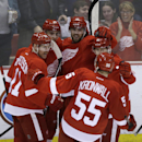 Detroit Red Wings, from left, Daniel Alfredsson, of Sweden; Tomas Jurco, of Slovakia; Riley Sheahan (15); Tomas Tatar (21), of the Czech Republic; and Niklas Kronwall,of Sweden celebrate Sheahan's goal during the third period of an NHL hockey game against