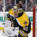 Boston Bruins goalie Tuukka Rask makes a save against the Detroit Red Wings during the first period of Game 2 of a first-round NHL hockey playoff series in Boston Sunday, April 20, 2014. (AP Photo/Winslow Townson)