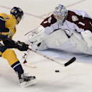 Nashville Predators defenseman Roman Josi (59), of Switzerland, has his shot blocked by Colorado Avalanche goalie Semyon Varlamov (1), of Russia, during a shootout at an NHL hockey game on Tuesday, March 25, 2014, in Nashville, Tenn. The Avalanche won the