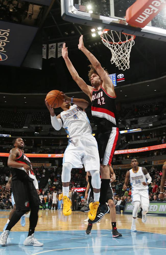 Denver Nuggets guard Randy Foye, front, goes up for a shot as Portland Trail Blazers center Robin Lopez in the fourth quarter of an NBA basketball game in Denver, Tuesday, Feb. 25, 2014. Portland won 100-95