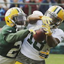 Green Bay Packers' Jarrett Bush, left, breaks up a pass intended for Randall Cobb during NFL football training camp Monday, July 28, 2014, in Green Bay, Wis The Associated Press