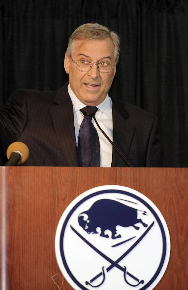 Buffalo Sabres' owner Terry Pegula, gestures toward the First Niagara Center and explains development plans during groundbreaking ceremonies before an NHL hockey game against the Philadelphia Flyers in Buffalo, N.Y., Saturday, April 13, 2013