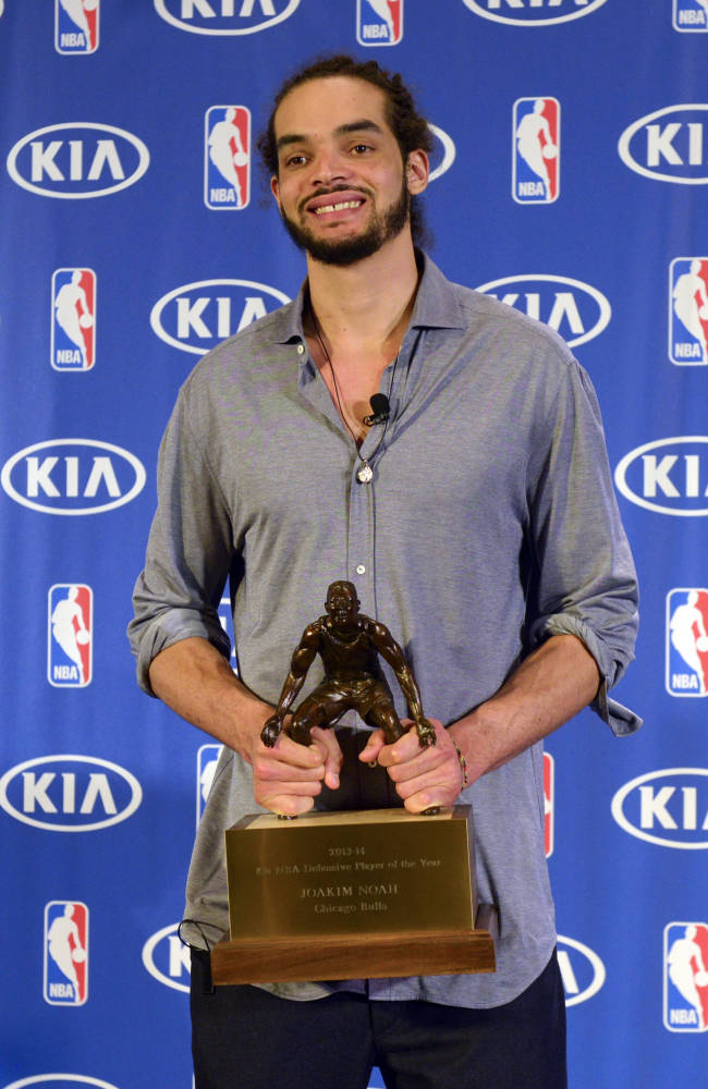 Chicago Bulls center Joakim Noah, holds the NBA Defensive Player of the Year trophy after receiving the award, Monday, April 21, 2014, in Lincolnshire, Ill