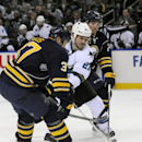 San Jose Sharks' Scott Hannan (27) skates between Buffalo Sabres' Matt Ellis, left, and Matt D'Agostini during the second period of an NHL hockey game in Buffalo, N.Y., Friday, Feb. 28, 2014 The Associated Press