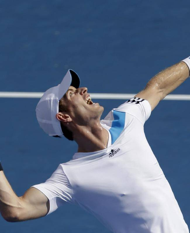 Britain's Andy Murray prepares to serve to Lleyton Hewitt of Australia during an exhibition match at the Kooyong Classic ahead of the Australian Open tennis championship in Melbourne, Australia, Friday, Jan. 10, 2014