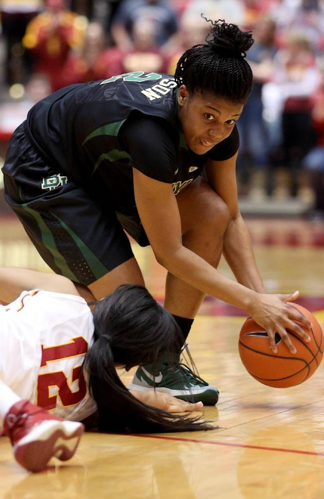 Baylor guard Niya Johnson picks up a loose ball that got away from Iowa State guard Seanna Johnson during the first half of an NCAA college basketball game in Ames, Iowa, Tuesday, March 4, 2014
