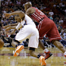 Charlotte Bobcats' Ramon Sessions, left, is fouled by Miami Heat's Ray Allen, right, during the first half of an NBA basketball game Sunday, Dec. 1, 2013, in Miami The Associated Press
