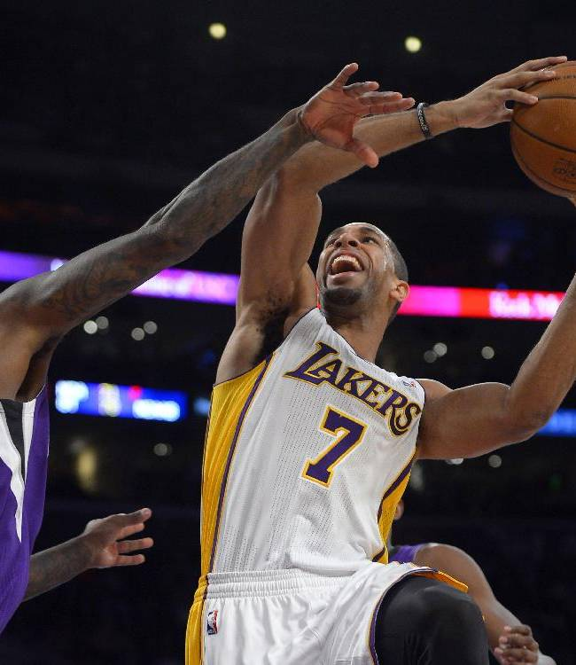 Los Angeles Lakers forward Xavier Henry, right, puts up a shot as Sacramento Kings forward John Salmons defends during the first half of an NBA basketball game Sunday, Nov. 24, 2013, in Los Angeles