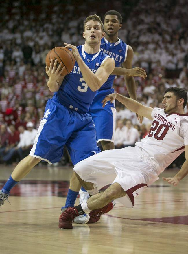 Kentucky guard Jarrod Polson, (3), collides with Arkansas guard Kikko Haydar, (20), as they attempt to receive an inbound pass during the second half of an NCAA college basketball game on Tuesday, Jan. 14, 2014, in Fayetteville, Ark.. Akansas defeated Kentucky 87-85 in overtime