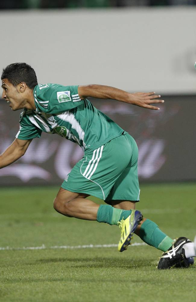 Raja Casablanca's Abdelilah Hafidi, center, and Raja Casablanca's Deo Kanda, right  celebrate after scoring against Auckland City FC during the opening game of the  Club World Cup soccer tournament in Agadir, Morocco, Wednesday, Dec. 11, 2013