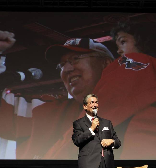 Washington Capitals fan Richard Hayden and his 4-year-old granddaughter, Meghan Hayden, are displayed on a video screen as he asked Washington Capitals majority owner Ted Leonsis a question during the team's Capitals Convention, Saturday, Sept. 21, 2013, in Washington. Leonsis announced that the team will host the NHL's annual Winter Classic outdoor hockey game on New Year's Day in 2015