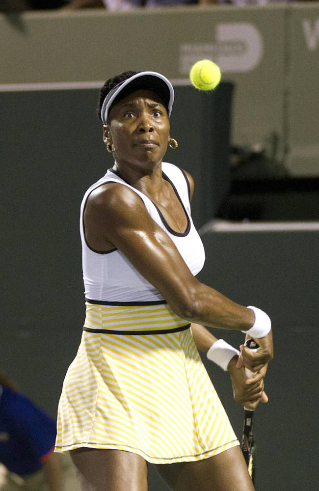 Venus Williams, of the United States, watches the ball hit by Dominika Cibulkova, of Slovakia, during the Sony Open Tennis in Key Biscayne, Fla., Monday, March 24, 2014